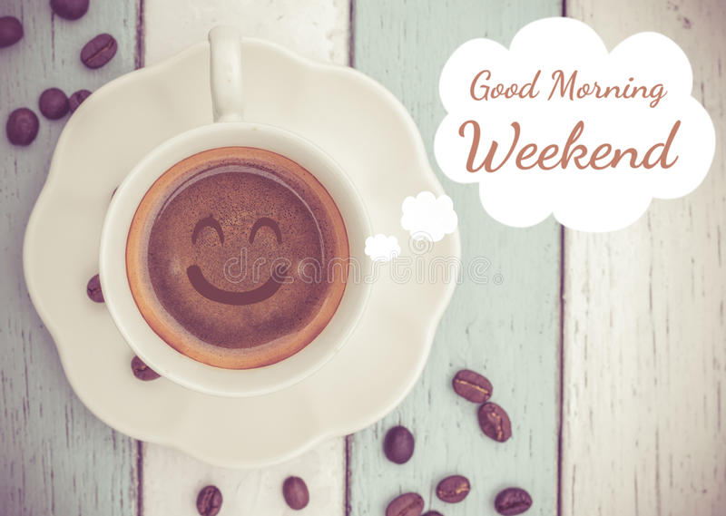 Good Morning weekend with coffee cup. Good Morning weekend with smile coffee cup on table royalty free stock image