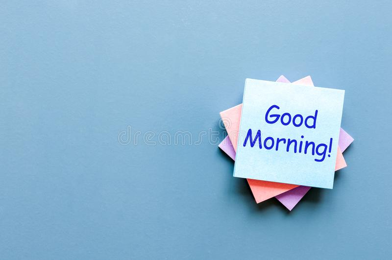 Good morning - wish for a good day. Note at blue background. With empty space for text, mockup and template.  stock images