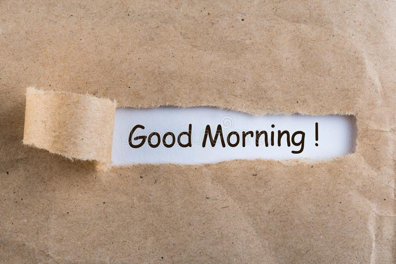 Good morning wishes in a torn envelope.  royalty free stock photo