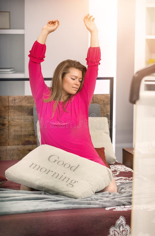 Good morning women at home. Girl woke up and waiting for good morning stock photography