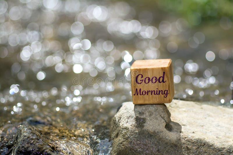 Good morning on wooden block royalty free stock photo