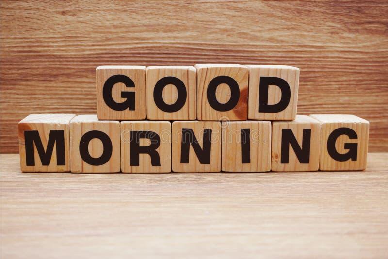 Good morning wooden letter alphabet on wooden background. Good morning wooden letters alphabet on wooden background royalty free stock photos