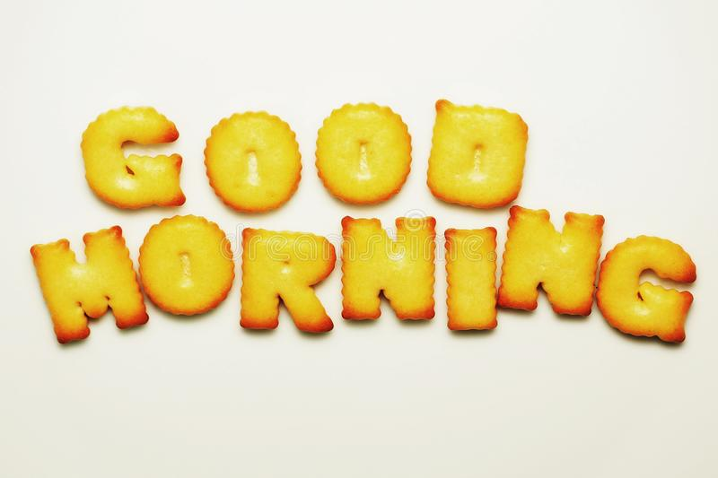 Good morning word from alphabet biscuits on white background. Love word from alphabet biscuits on white background. from, , say, food, snack, letters, text royalty free stock image