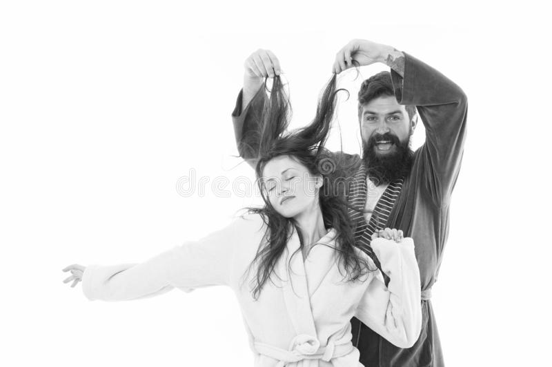 Good morning world. Go from flat to fluffy. happy bearded man play with hair of sleepy girl. family couple in robe. Love royalty free stock photos