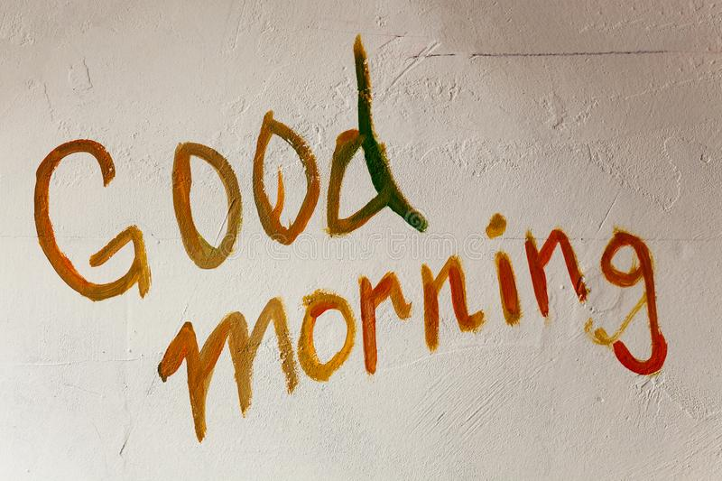 Good Morning on Wall. Good morning written on old white wall royalty free stock image