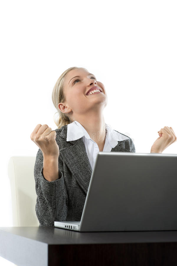 Good news!. Attractive young business woman receiving good news while working on her laptop, isolated on white royalty free stock photos