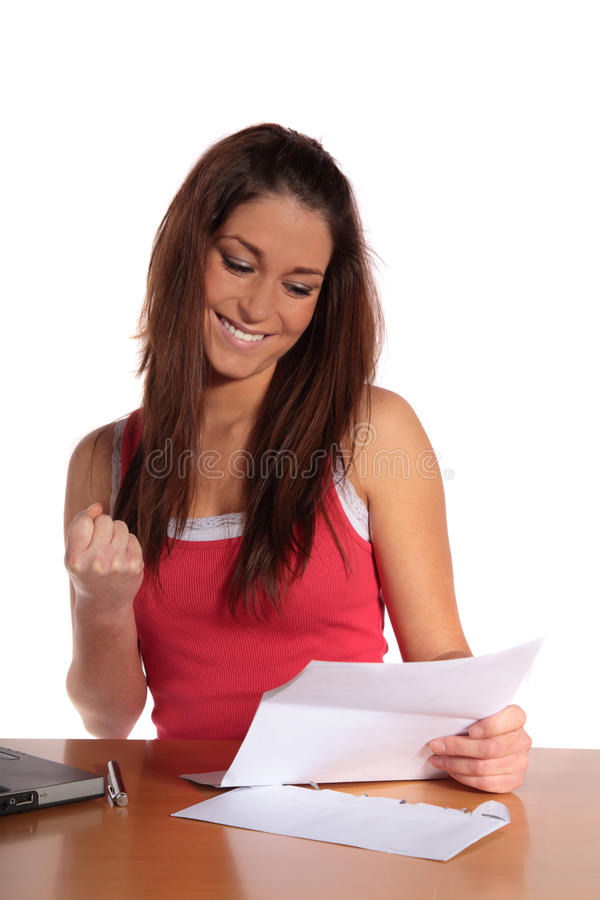 Good news. An attractive young woman gets good news via mail. All isolated on white background royalty free stock photography