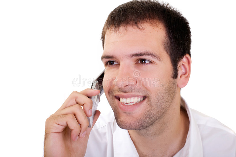 Good news. Potrait of a young man speaking on the phone royalty free stock images