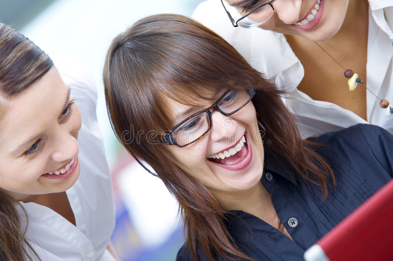 Good news. Portrait of young pretty women discussing project in office environment royalty free stock photography