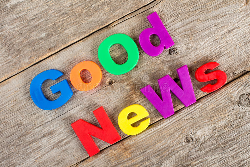 Good news concept. Colored letter magnets spelling text GOOD NEWS stock images