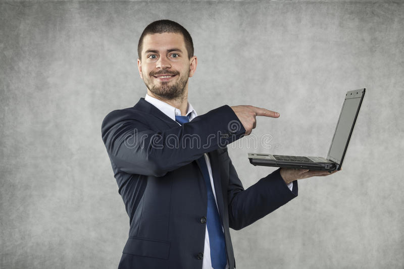 Good news from the internet. Happy business man royalty free stock photography