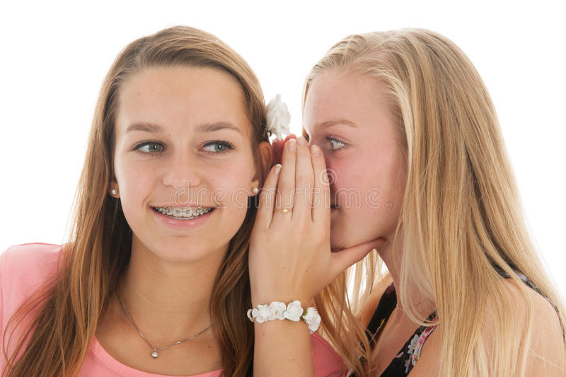 Good news. Teen girls are whispering gossip with good news royalty free stock image