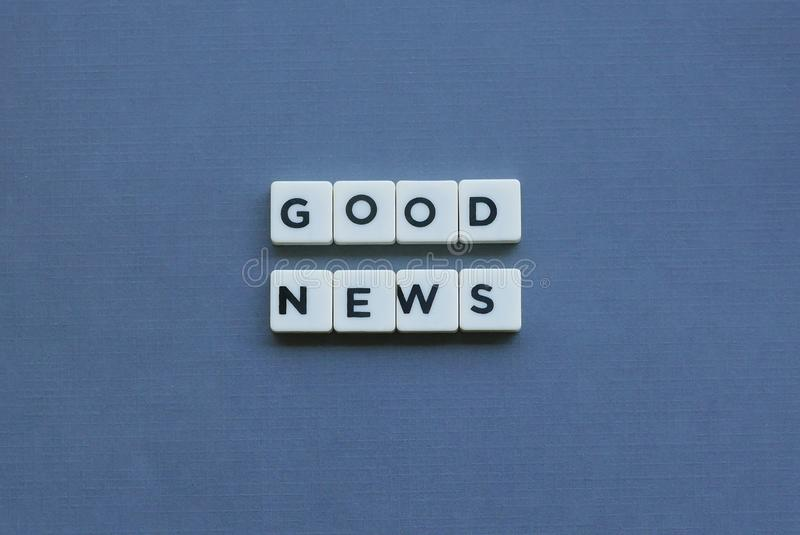 ' Good News ' word made of square letter word on grey background stock photos