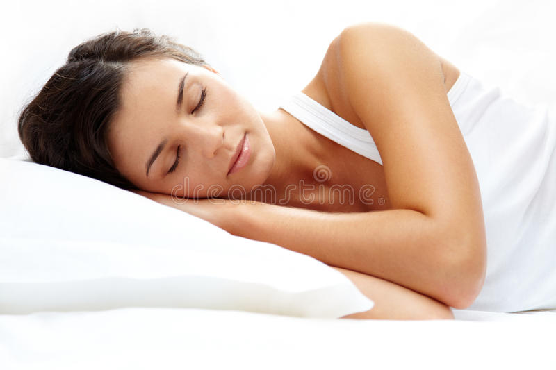 Good night. Portrait of a young girl sleeping on a pillow stock photo