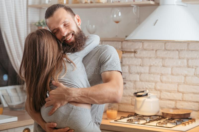 Good night hug happy family father daughter. Good night hug. Happy family. Loving father holding his little daughter in kitchen, smiling royalty free stock images