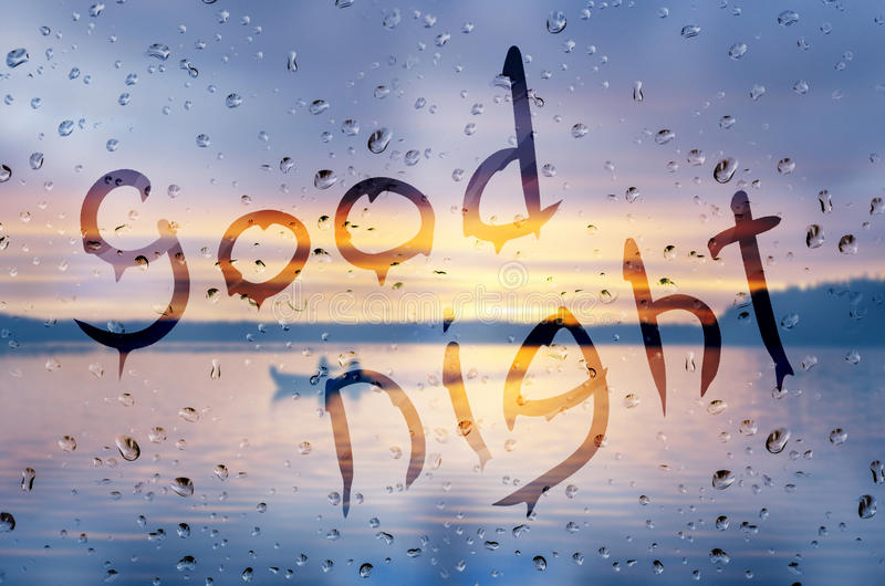 Good night. Rain on glass with Good night text stock photo