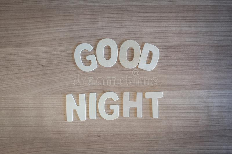 Good Night words with wood letters over wood background stock image