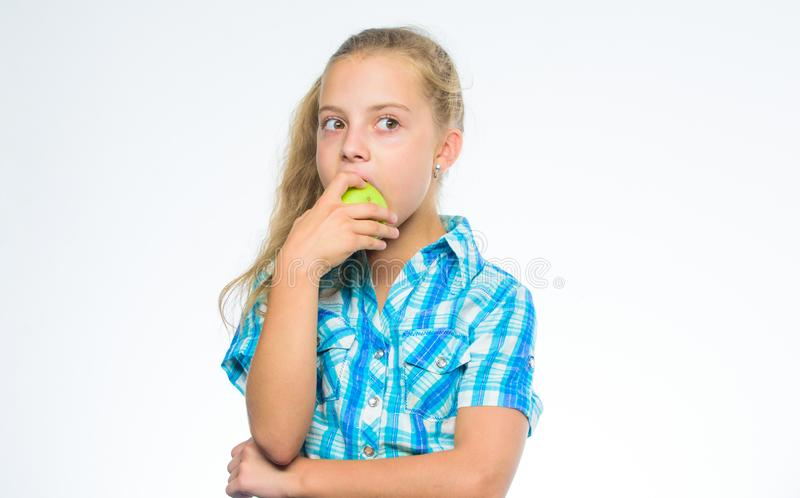 Good nutrition is essential to good health. Find out which vitamins and minerals your body need. Kid girl eat green. Apple fruit. Nutrition vitamin content of stock photo