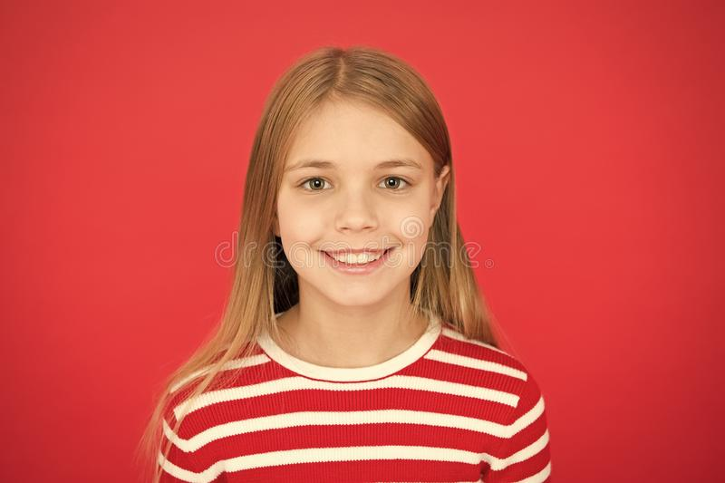 Good parenting. Child care. family and love. childrens day. happy little girl on red background. small girl child stock photos