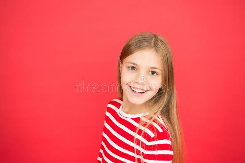 Good parenting. Child care. family and love. childrens day. happy little girl on red background. small girl child. School education. Childhood happiness. copy royalty free stock photos