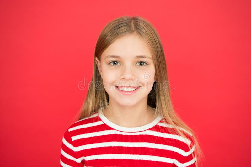 Good parenting. Child care. family and love. childrens day. happy little girl on red background. small girl child. School education. Childhood happiness. I royalty free stock image