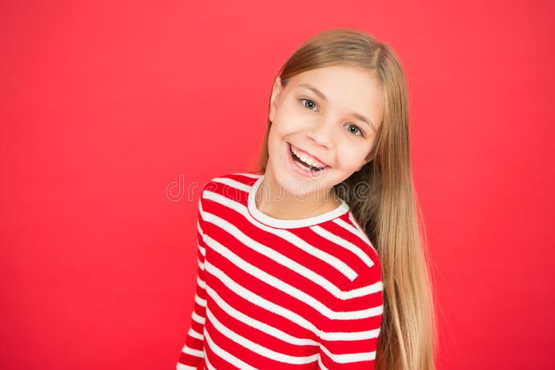 Good parenting. Child care. small girl child. School education. family and love. childrens day. happy little girl on red. Background. Childhood happiness. copy stock photography
