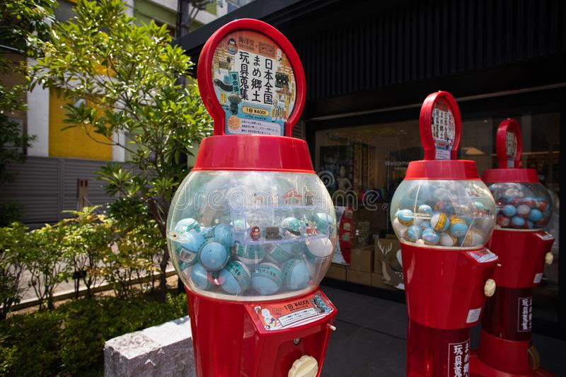 Japanese souvenirs with cute sika deers in capsule toys machine gashapon in Nara, Japan royalty free stock photos