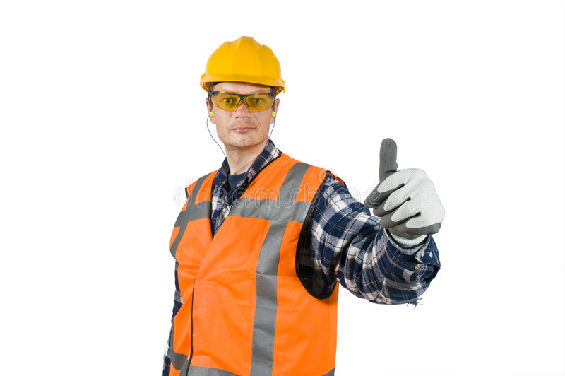 Good practise. A construction worker, wearing the proper safety precautions, giving a thumbs-up, showing good practice stock image