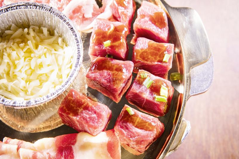 Good quality beef with cheese on metal pan preparing for cooking stock images