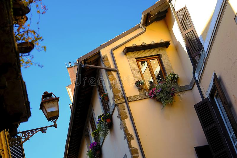 Cosy towns and small houses. Good quality photo of an interesting example of some old European architecture. You may see yellow building in warm sunlight, dark stock image