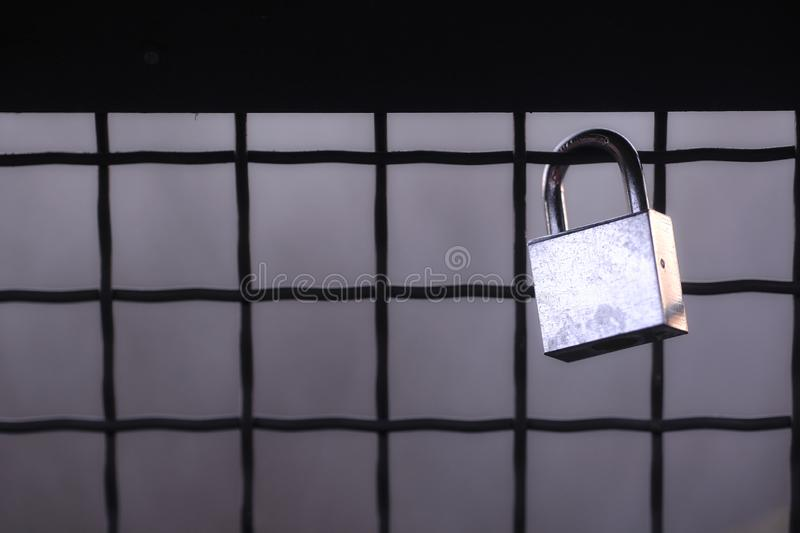 Black and white, steel cold padlock. Good quality photo of a steal wedding lock or padlock hanged somewhere in the street. Main focus is made on quite spartan royalty free stock images