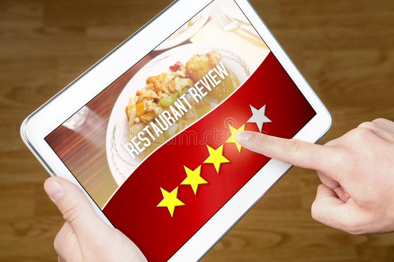 Good restaurant review. Satisfied and happy customer stock image