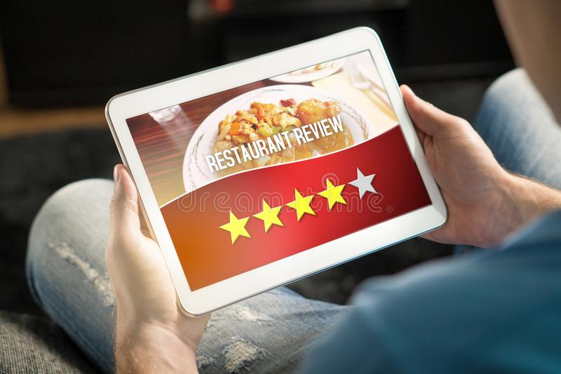 Good restaurant review. Satisfied and happy customer. royalty free stock photo
