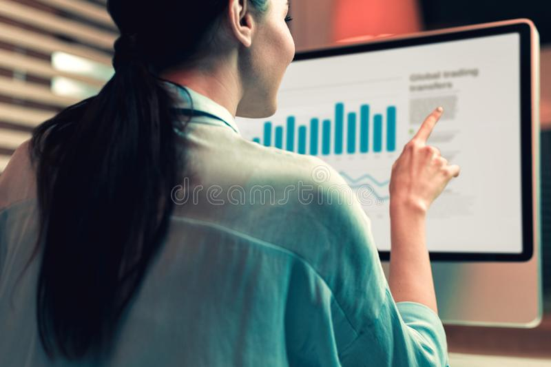 Creative woman making presentation about firms profit stock images