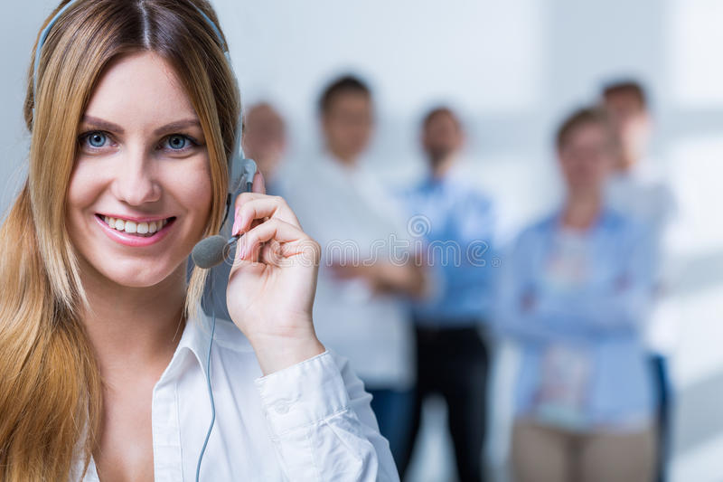 Good results in the work. Pleasant telemarketer has very good results in the work stock image