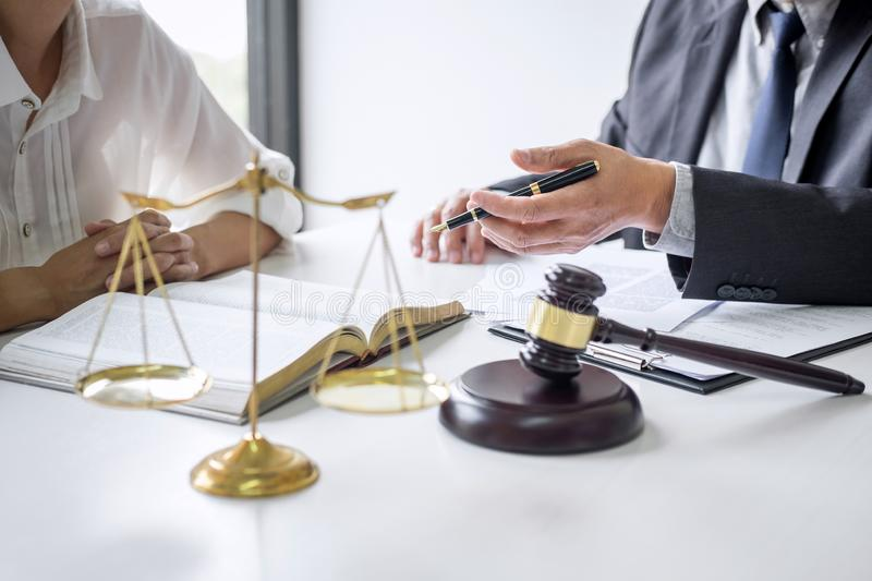 Good service cooperation, Consultation of Businesswoman and Male lawyer or judge counselor having team meeting with client, Law. And Legal services concept stock photo