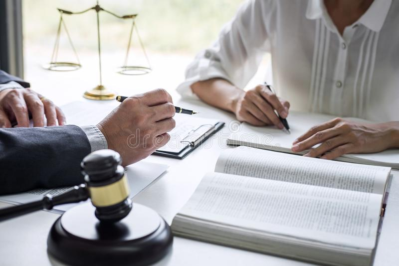 Good service cooperation, Consultation of Businesswoman and Male lawyer or judge counselor having team meeting with client, Law. And Legal services concept stock photography