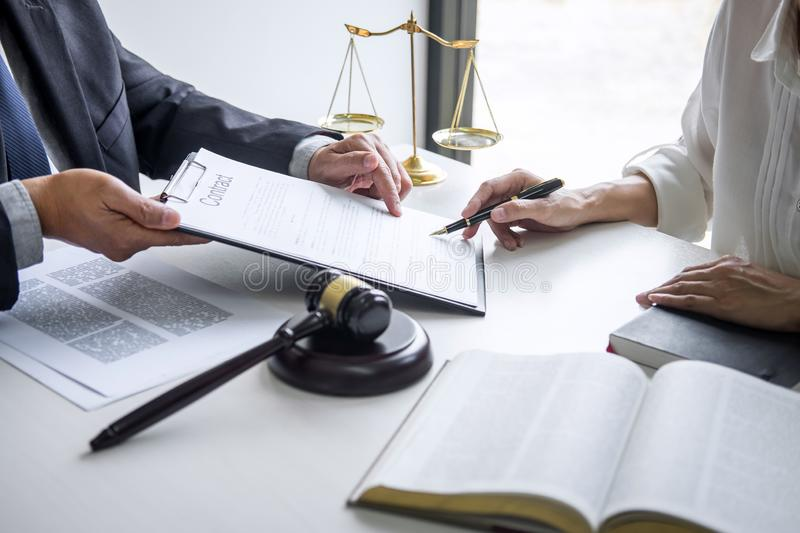 Good service cooperation, Consultation of Businesswoman and Male lawyer or judge counselor having team meeting with client, Law stock photography