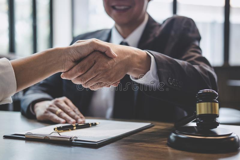 Good service cooperation of Consultation between a male lawyer and business woman customer, Handshake after good deal agreement,. Good service cooperation of stock photos