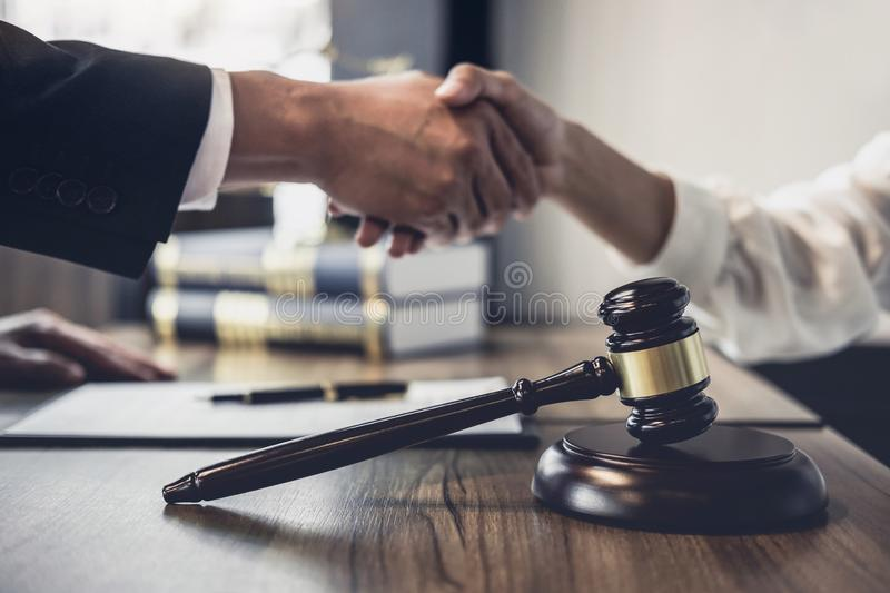 Good service cooperation of Consultation between a male lawyer and business woman customer, Handshake after good deal agreement,. Good service cooperation of royalty free stock image