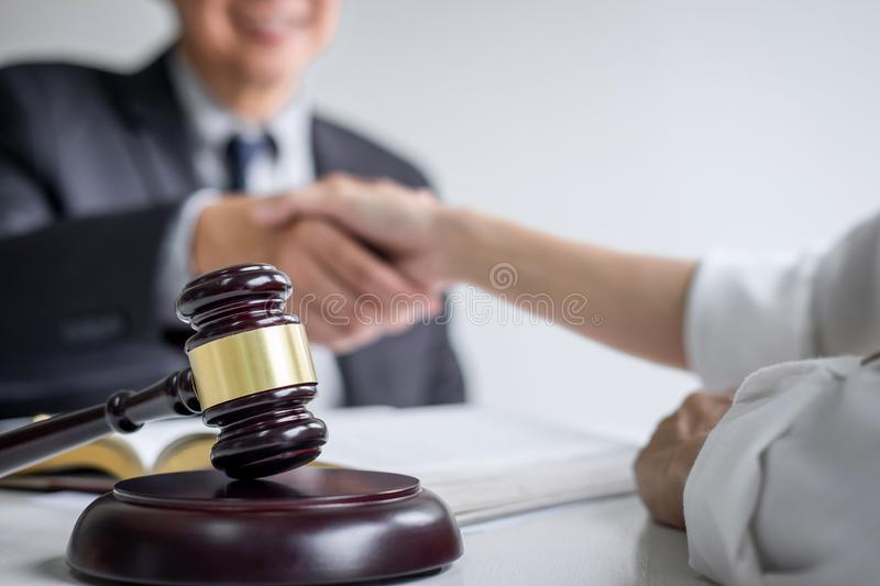 Good service cooperation of Consultation between a male lawyer and business woman customer, Handshake after good deal agreement,. Good service cooperation of stock image
