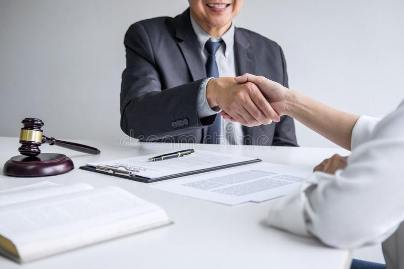 Good service cooperation of Consultation between a male lawyer and business woman customer, Handshake after good deal agreement,. Good service cooperation of stock images