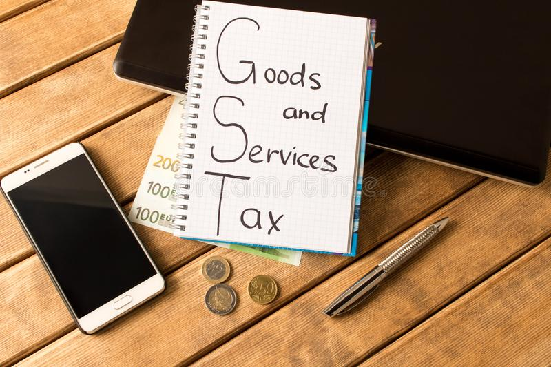 Good service and tax . Laptop, pen, coins,banknotes, smartphone royalty free stock photography