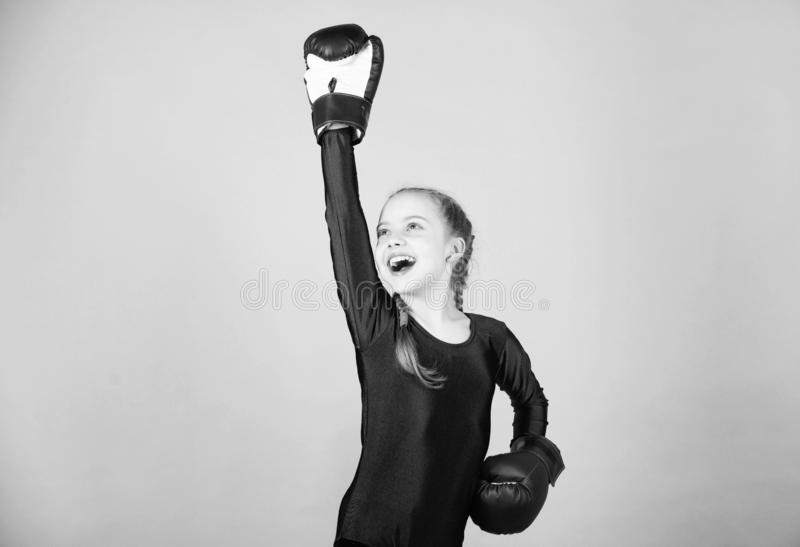 Always in good shape. Sport success. sportswear fashion. workout of small girl boxer. punching knockout. Childhood. Activity. Fitness diet. energy health. Happy royalty free stock photo