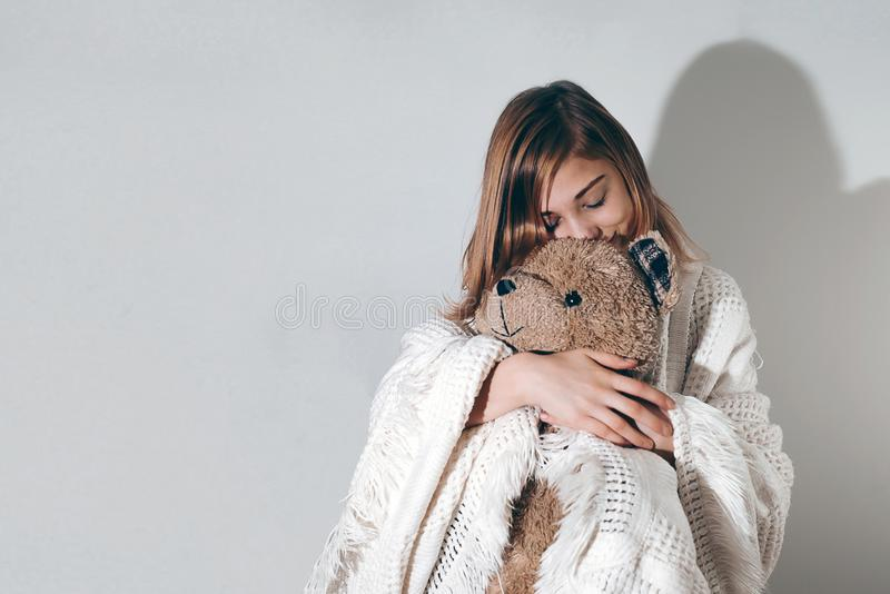 Good sleep concept girl standing with teddy and blanket. Going t. Good sleep concept girl standing with teddy and blanket. Studio photoshoot with lots of copy stock photo
