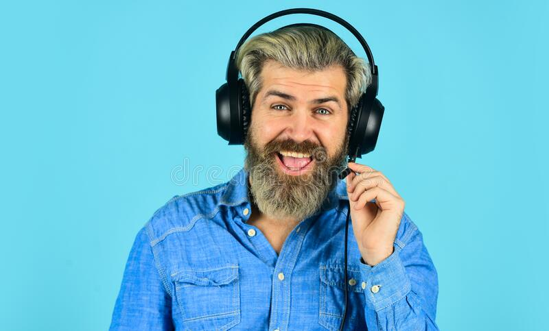 Good smile. Music beat for energetic mood. his favorite song. enjoy excellent sound song in earphones. good mood royalty free stock image