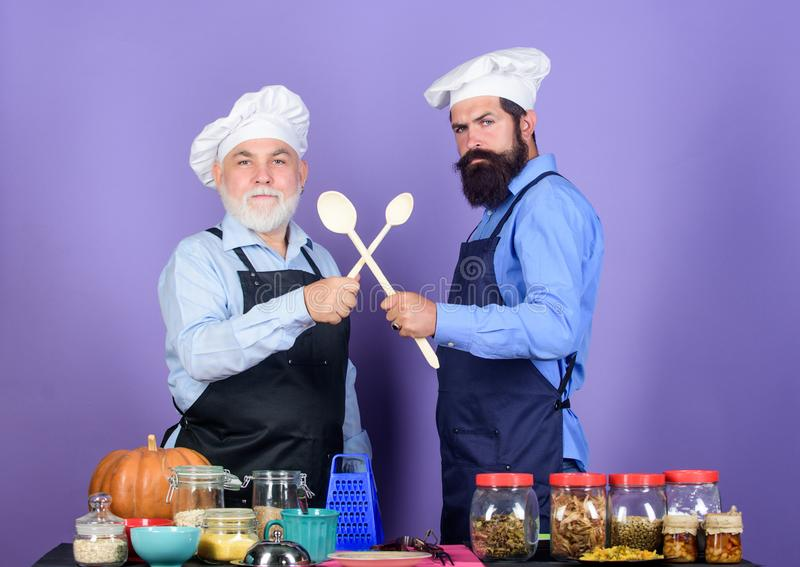 Good team. cereals and seasoning. professional restaurant cook. Halloween pumpkin recipe. Chef men cooking. cheerful men. Prepare food. mature senior bearded royalty free stock photo