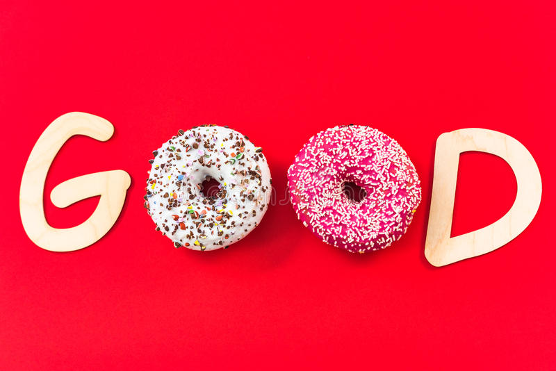 Good text made from donuts, bright colors. Good concept royalty free stock photo