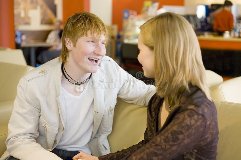 Good time at Cafe. Man and woman are sitting at Cafe and having conversation. Short depth of focus on man's face royalty free stock photo