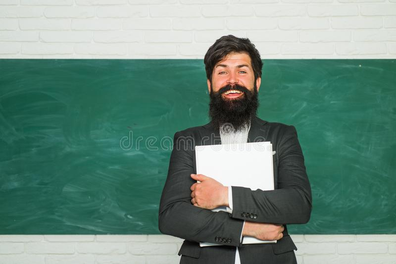 Good tutors are often communication masters. Serious male Student studying in school. Learning and education concept. Teachers day - knowledge and educational stock photography
